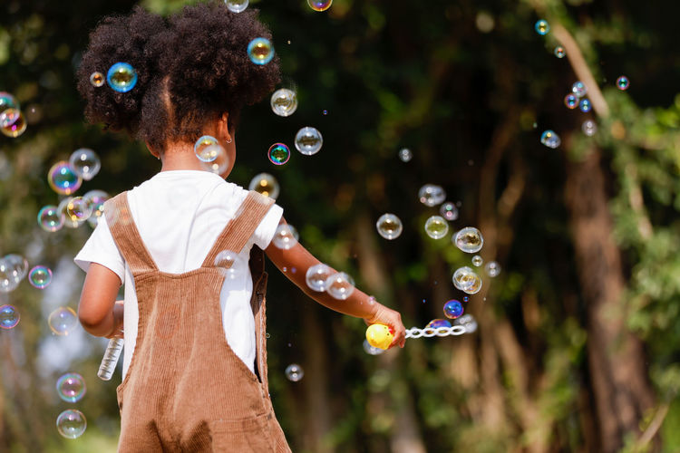 High angle view of woman standing at bubbles