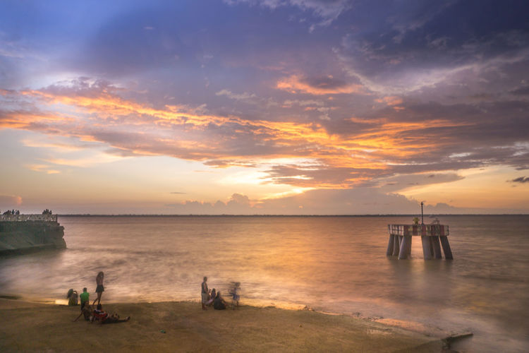Beach Beauty In Nature Cloud - Sky Day Horizon Over Water Nature Outdoors Scenics Sea Sky Sunset Tranquil Scene Tranquility Water