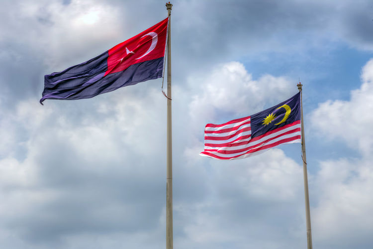 State flag of Malaysia And Johor bahru Flag.Malaysia flag also known as Jalur Gemilang wave with the blue sky. People fly the flag in conjunction with the Independence Day celebration or Merdeka Day.Johor Bahru is One of the states under the administration of malaysia Cloud - Sky Day Emotion Environment Flag Low Angle View National Icon Nature No People Outdoors Patriotism Pole Pride Red Sky Striped Waving Wind