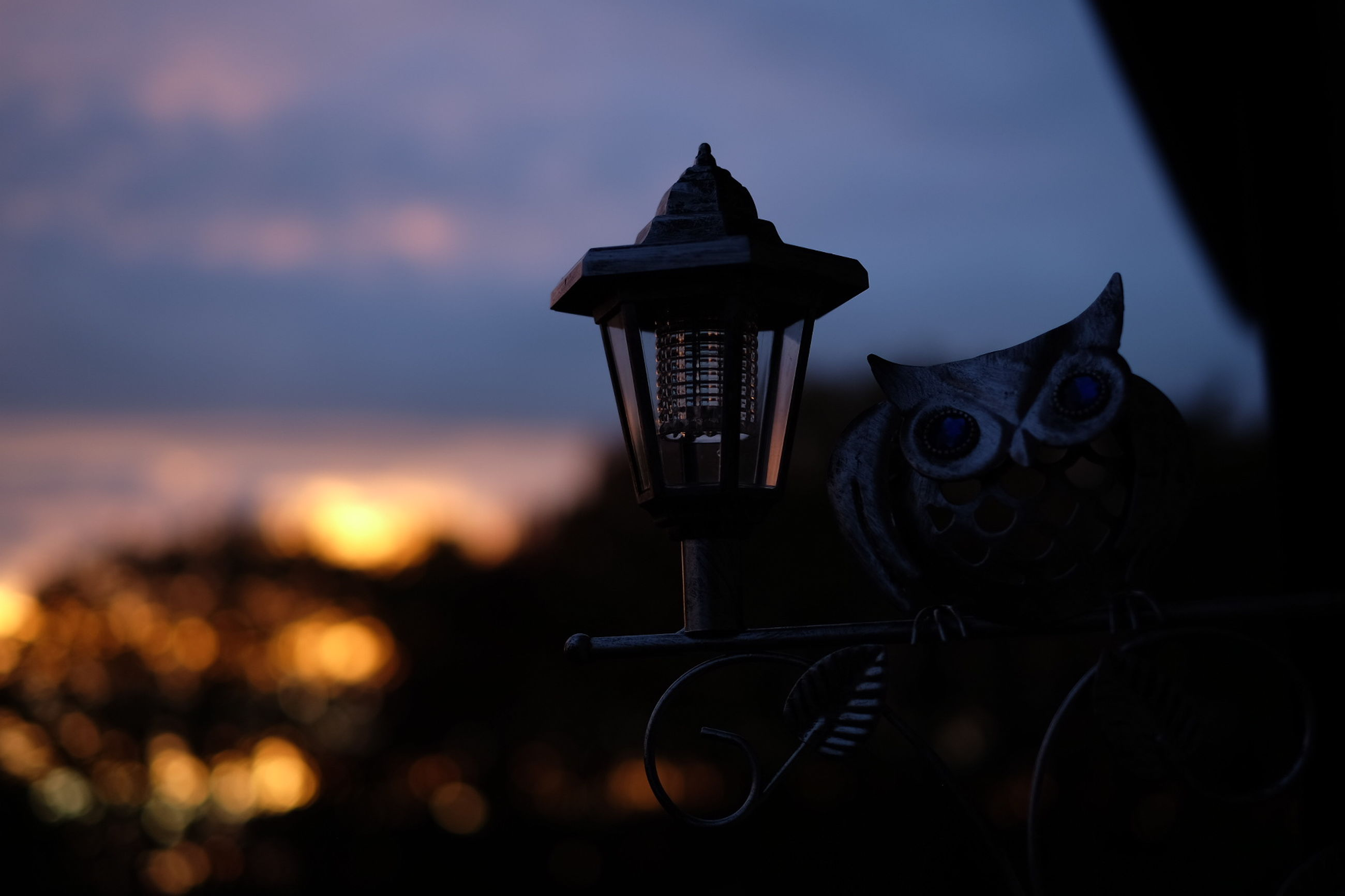 focus on foreground, illuminated, close-up, lighting equipment, selective focus, low angle view, sky, no people, metal, silhouette, night, dusk, lantern, sunset, outdoors, electricity, glowing, electric light, still life, street light