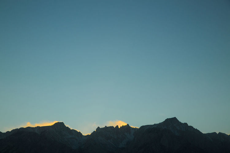 Low angle view of mountain range against clear sky