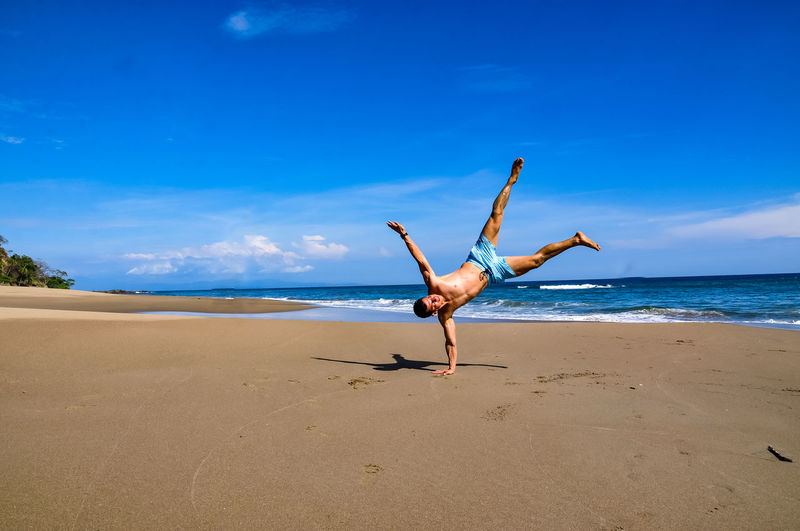 Low angle view of person on beach against sky