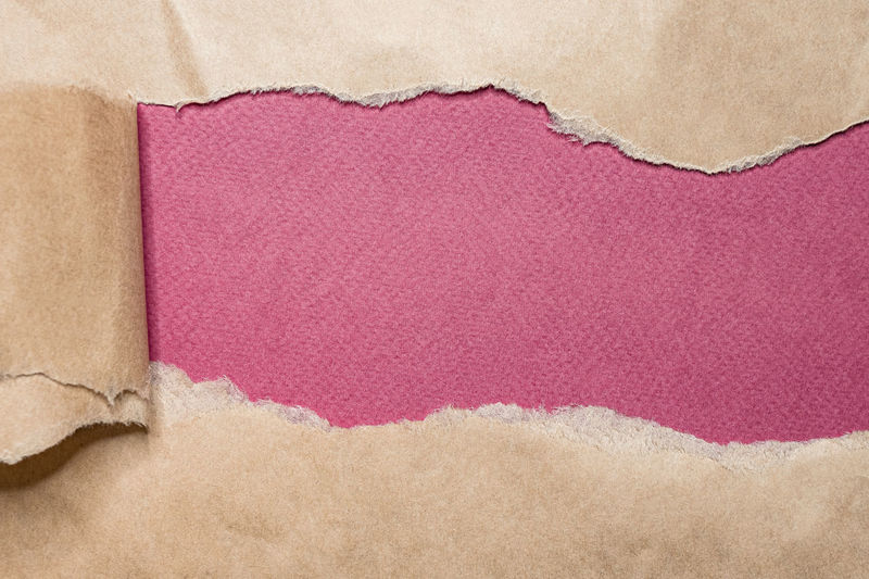 Close-up of pink paper against white background