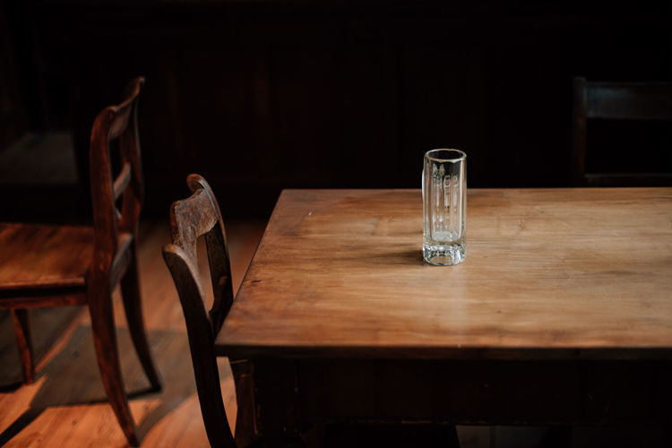 Empty drinking glass on table in restaurant