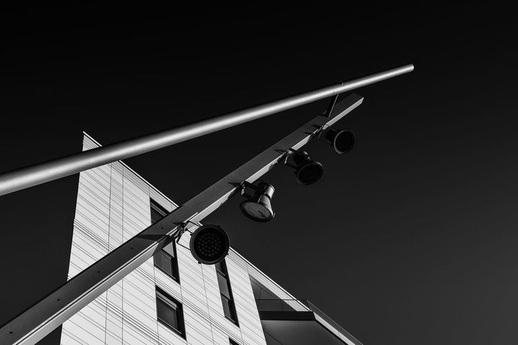 lantern Blackandwhite Façade Windows Minimalism_bw Low Angle View No People Sky Technology Lighting Equipment Architecture Clear Sky Nature Copy Space Built Structure Building Exterior Day Outdoors Security Camera Communication Protection Metal Street Sign Security System