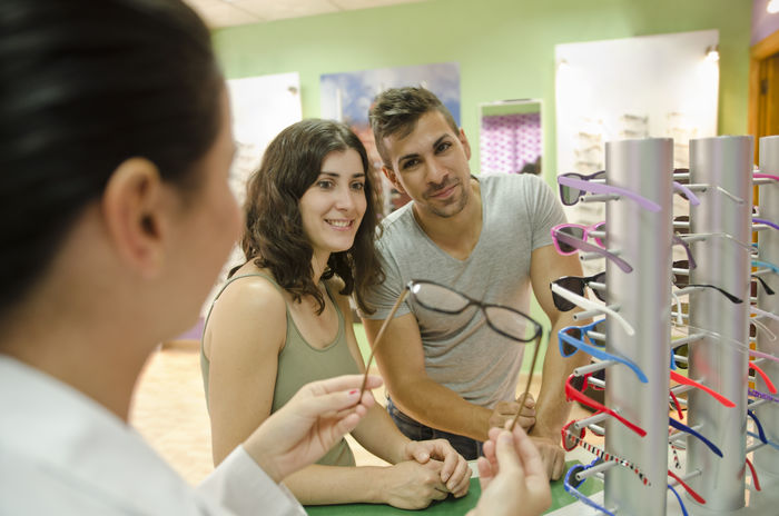 Optometrist store sell glasses to young couple 30 Years Old Eye Test Pharmacy Spanish Woman Work Adult Buy Casual Clothing Choice Choose Consumerism Customer  Day Eye Eye Test Equipment Eyesight Friendship Indoors  Lab Lenses Lifestyles Men Optician Opticians Optometrist Optometry People Real People Retail  Shop Smiling Standing Store Test Togetherness Variation Vision Women Young Adult Young Women