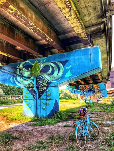 Toronto street art EyeEmNewHere Underpass Mode Of Transportation Concrete Structure Contrasting Colors Urban Landscape Visual Communication Artistic Expression Graffiti Art Blue Bicycle Explore Your City Toronto Street Photography Streets Of Toronto Art is Everywhere Painted Wall Creativity No People Architecture Representation Built Structure Day Outdoors Street Art Multi Colored Pattern