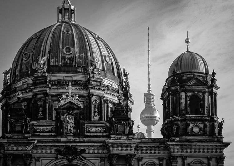 Low angle view of berlin cathedral by fernsehturm against sky