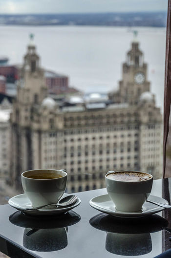 Taken from Panoramic34 (Liverpools highest restaurant) the famous Liver Buildings provide a beautiful backdrop for what was actually a very nice coffee! Coffee Cups Focus On Foreground Liver Building's Liverpool Liverpool No People Selective Focus View