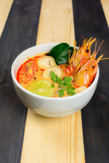 High angle view of prawns in bowl on table