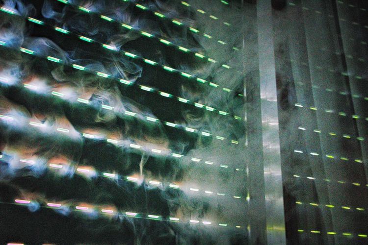 Full frame shot of illuminated glass lights