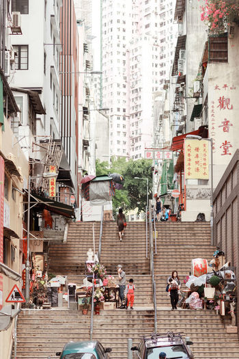 Hong Kong Hong Kong City Architecture Building Building Exterior Built Structure City City Life Crowd Day Group Of People Leisure Activity Lifestyles Location Modern Neighborhood Outdoors People Real People Residential District Staircase Street The Architect - 2018 EyeEm Awards The Street Photographer - 2018 EyeEm Awards
