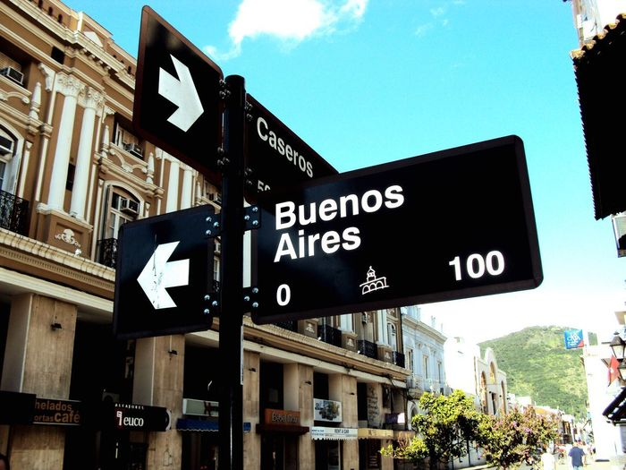 Buenos Aires Road Sign Guidance Communication Direction Argentina Outdoors No People Street Name Sign EyeEmNewHere EyeEm Selects Urban Building Exterior Argentina Photography Argentina 👑🎉🎊👌😚😍 Argentinaphotography Caseros