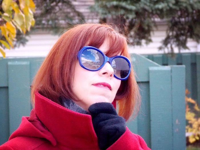 Close-Up Of Thoughtful Woman Wearing Sunglasses During Winter