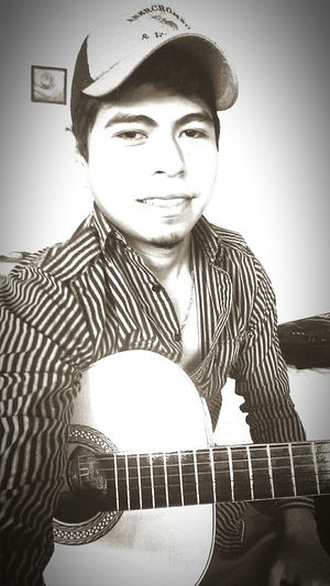 A beautiful day, playing the guitar, is perfect moment