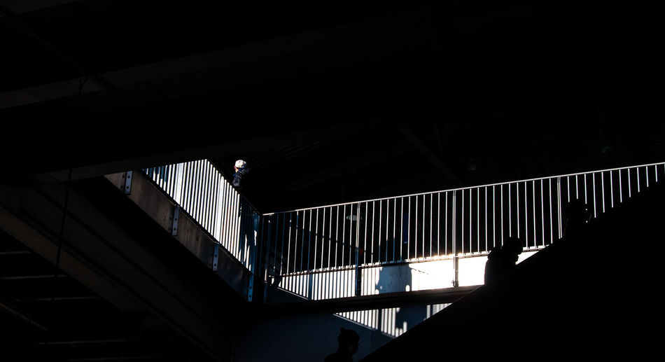 Low angle view of silhouette person on staircase
