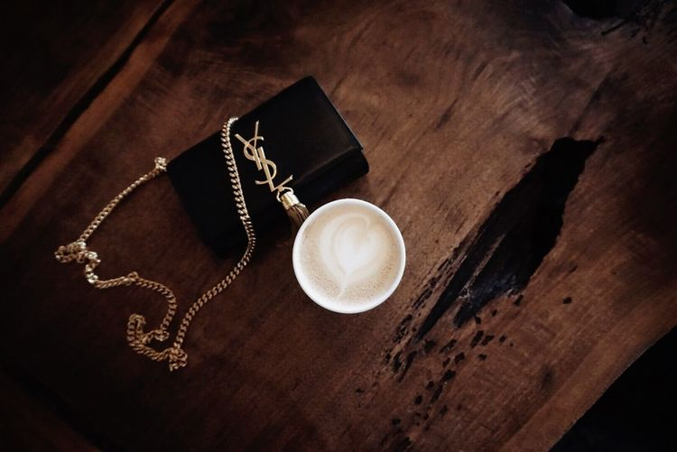Table Still Life Coffee - Drink Coffee High Angle View Coffee Cup Wood - Material Drink Indoors  Food And Drink Mug Cup Refreshment No People Frothy Drink Jewelry Cappuccino Freshness Heart Shape Close-up
