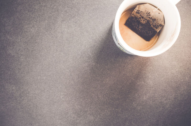 empty tea cup still life Backdrop Close-up Creative Photography Cup Elevated View Freshness Indulgence Minimalism No People Refreshment Rough Texture Serving Size Still Life Surface Tea Time
