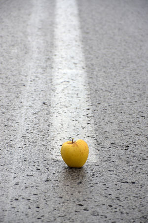 Apple Asphalt Road Yellow Apple Concept Day Fruit Middle Of The Road No People Outdoors Red Apple Ripe Apple Road Lines