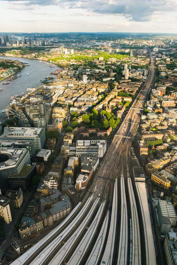 London Aerial View Architecture Bridge - Man Made Structure Building Exterior Built Structure City City Life Cityscape Day England High Angle View Mode Of Transport No People Outdoors Public Transportation Rail Transportation Railroad Track Sky Skyscraper Sunset The Shard Transportation Travel Destinations Urban Skyline