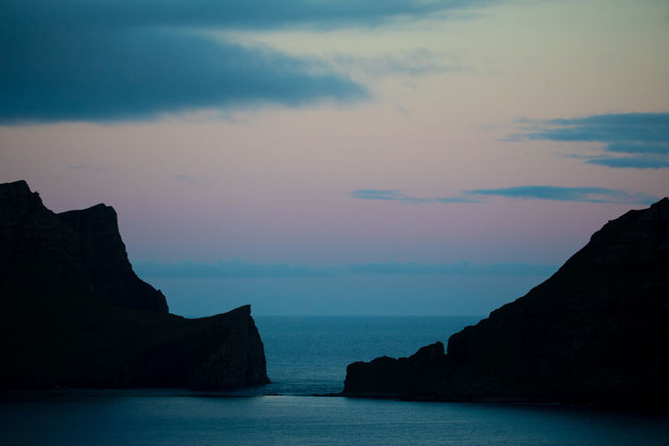 Scandinavia Sunset Silhouettes Tadaa Community Beauty In Nature Cloud - Sky Faroe Islands Horizon Horizon Over Water Idyllic Nature No People Outdoors Rock Rock - Object Rock Formation Scenics - Nature Sea Sky Solid Stack Rock Sunset Tranquil Scene Tranquility Water Waterfront