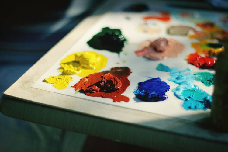 Close-up of color paints on palette