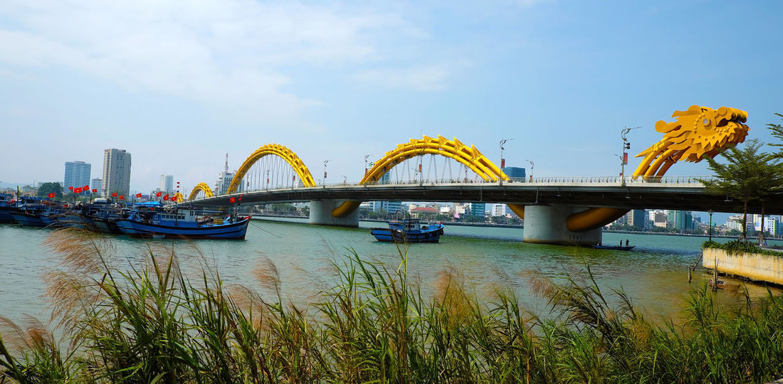 DA NANG, VIET NAM- FEB 18, 2016: Rong bridge also name Dragon bridge cross Han river with modern winding architect, symbol of Danang city, Vietnam ASIA Asian  Bridge City Cross Da Nang Da Nang,viet Nam Danang Day Dragon Dragon Bridge Han River Infrastructure Landscape Landscaping Modern Panorama River Riverside Symbol Viet Nam Vietnam Vietnamese Water Yellow