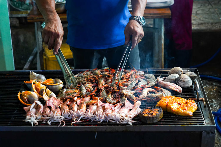 Street food on phu quoc island in vietnam. delicious seafood for tourist at market at night.