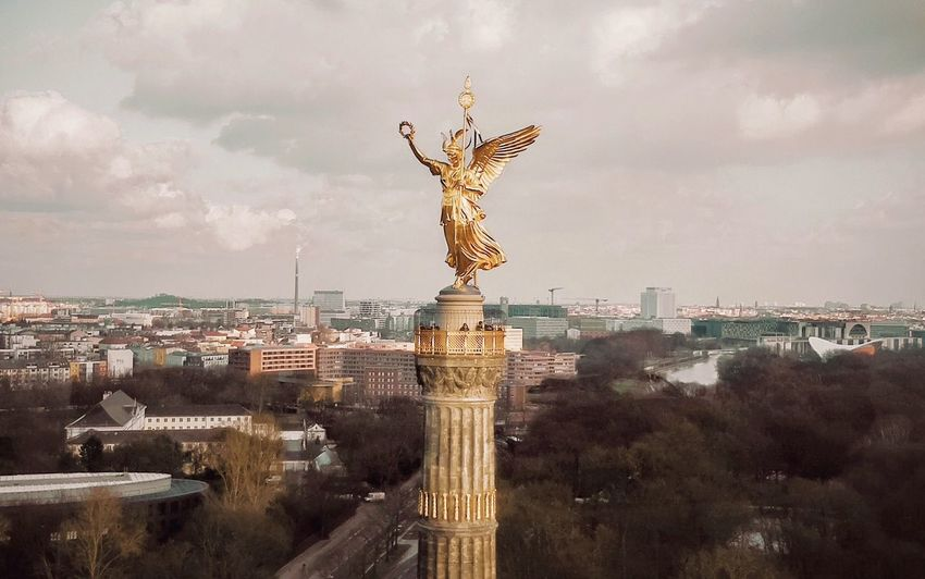 - NEXT TIME I'LL COME A BIT CLOSER TO HUG YOU, GOLDEN GIRL - DJI X Eyeem Check This Out Drone Photography Dronephotography Drone  History My Fuckin Berlin Momument Berlin Goldelse Statue Sculpture Cloud - Sky Human Representation Sky Architecture Travel Destinations Built Structure City Tourism Travel Outdoors Gold Colored Day
