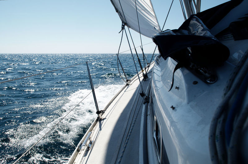 The wind has picked up and we're sailing now! Heeled over and pushing past through the waves. Close-hauled Full Sail Heeled Over Sailing Yacht Sea Sun On The Deck Sunny Summer's Day îles Chausey