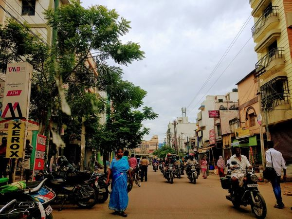 Madurai Dailylifeindia building exterior City Architecture Large Group Of People Tree Built Structure City Life Walking Real People Men Sky People Lifestyles Women Outdoors Day Motorcycle Adult Crowd Adults Only