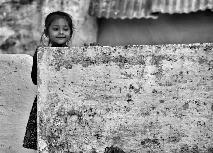 portrait Looking At Camera Childhood One Person Outdoors Day Smiling People Child Girlchild Innocent Childslook Blackandwhite Blackandwhite Photography Portraitofagirl Wall