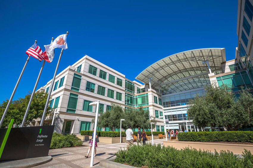 Cupertino, California, United States - August 15, 2016: the Apple world headquarters at One Infinite Loop. Apple is a multinational that produces consumer electronics, personal computers and software. people come from the popular Apple store of Apple Inc Headquarters at One Infinite Loop located in Cupertino, Silicon Valley, California. Apple California IT Mac PC United States Architecture Blue Building Building Exterior Built Structure City Clear Sky Computer Cupertino Day Electronics Industry Flag Headquarter Headquarters Hq IMac27 IPhone Imac Infinite Loop Mobile No People Outdoors Patriotism Sky Store Tree