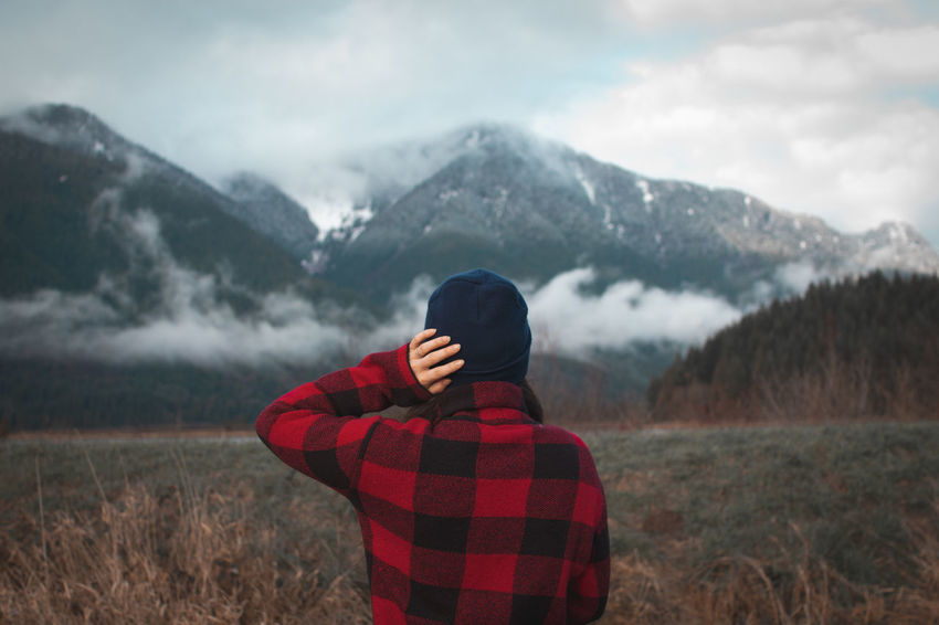 woman in plaid shirt looking at snow capped mountains Mountain One Person Scenics - Nature Winter Beauty In Nature Non-urban Scene Tranquil Scene Landscape Mountain Range Tranquility Cold Temperature Real People Environment Nature Cloud - Sky Clothing Sky Land Field Warm Clothing Outdoors Snowcapped Mountain Woman Wool Hat Plaid Shirt