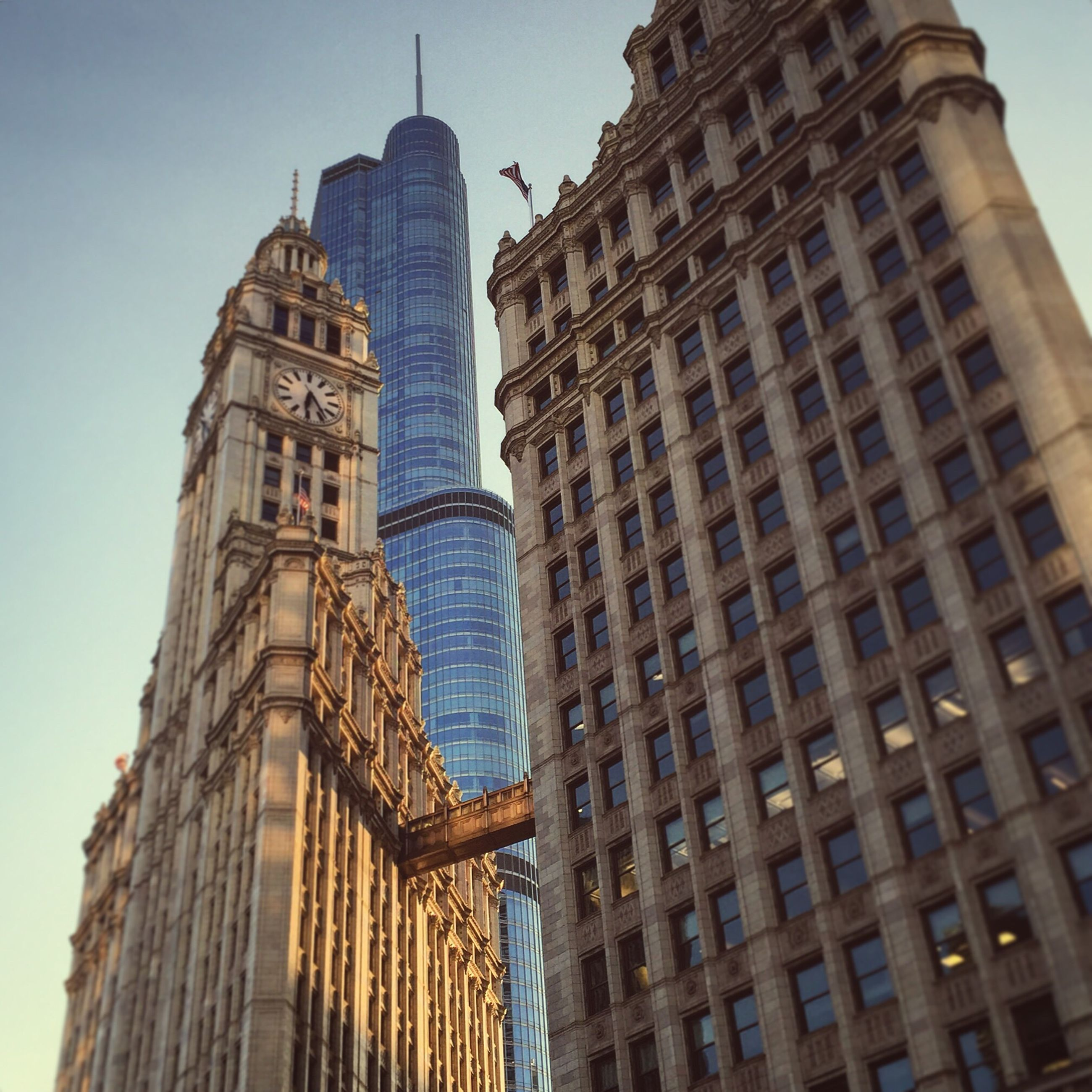 building exterior, architecture, built structure, low angle view, tall - high, tower, city, skyscraper, modern, office building, famous place, capital cities, travel destinations, clear sky, international landmark, building, tourism, day, travel, tall
