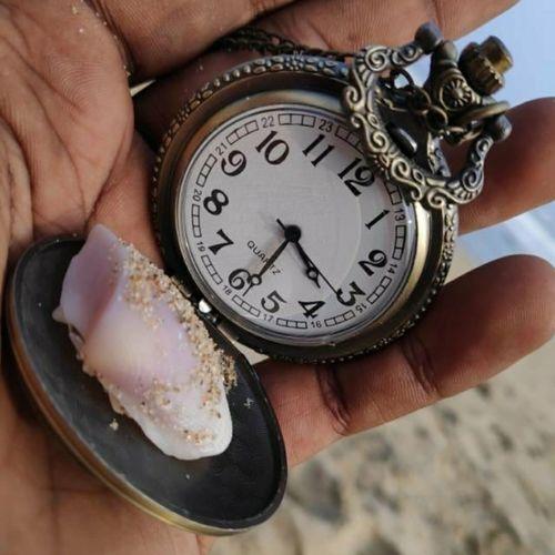 Close-up of hand pocket watch
