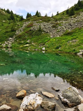 Alps Pond Reflection Rock - Object Tranquil Scene Nature Tranquility Water Outdoors Beauty In Nature Day No People Scenics Green Color Landscape Lake Moss Mountain Grass