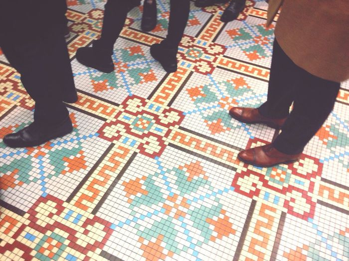 Feet Human Leg Real People Pattern Standing Tiled Floor Indoors  Look Down Low Angle View LINE Waiting In Line Paris Ground