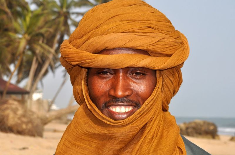 Targi Itinerant People Itinerant Desert People Desert Tribe Nomadic Tribe Nomadic Life Nomadic People Portrait Headshot Focus On Foreground Adult Looking At Camera Smiling Happiness Front View Emotion Outdoors Human Face Africa Ghana Mali Tuareg Berber  Sahara Desert Traditional Traditional Clothes NOMAD Faces Of Africa Happiness