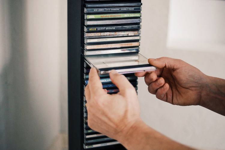 Midsection of people holding book