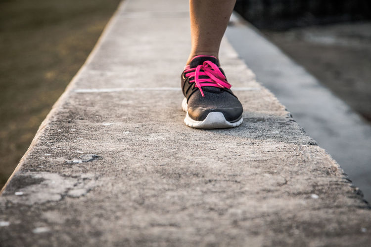 Body Part Day Exercising Footpath Healthy Lifestyle Human Body Part Human Foot Human Leg Human Limb Leisure Activity Lifestyles Low Section Nature One Person Outdoors Running Selective Focus Shoe Sole Of Shoe Sport Sunlight
