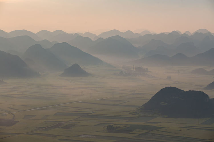 Tranquil Scene Scenics - Nature Beauty In Nature Tranquility Sky Mountain Environment Non-urban Scene Landscape Mountain Range Idyllic Sunset No People Nature Fog Physical Geography Outdoors Mountain Peak