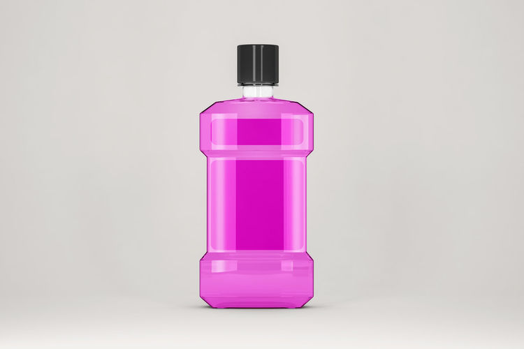 Close-up of pink bottle against white background