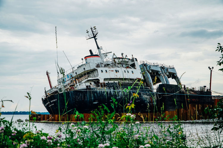 Abandoned Boat Clouds Cloudy Day Derelict Derelict & Abandoned Mode Of Transport Nautical Vessel No People Outdoors Rusted Ship Shipwreck Sky Sky And Clouds Transportation Water Wreck