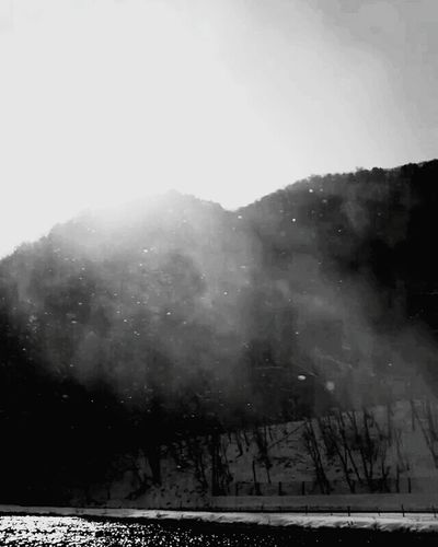 Winter Snow Cold Temperature Snowing Fog Outdoors Weather Nature No People Mountain Tree Frozen Sunlight Beauty In Nature Day Landscape Forest Sky Snowflake Blackandwhitepics Black And White Collection  Blackandwhite Photography Blackandwhite Monochrome World Lost In The Landscape