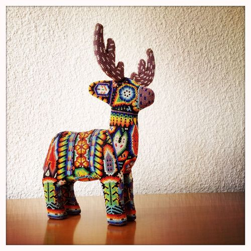 A small sculpture of a deer, made in the traditional Mexican huichol technique. Mexico Arts And Crafts Mexican Culture Huichol Deer Colourful Traditional Art Ornate EyeEm Bestsellers