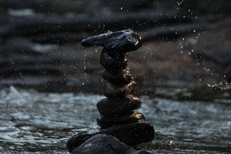 Water splashing on rock in lake