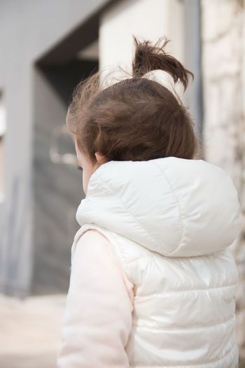 Rear view of girl standing outdoors