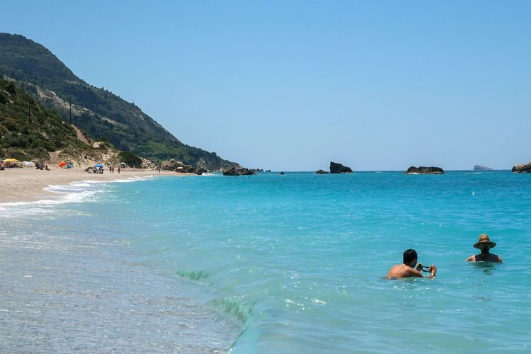 Beach Vacations Sea Swimming Sunny Two People Relaxation Water Tropical Climate Summer Travel Destinations Leisure Activity Enjoyment Travel Lefkada Greece Kathisma Kathisma Beach Lost In The Landscape