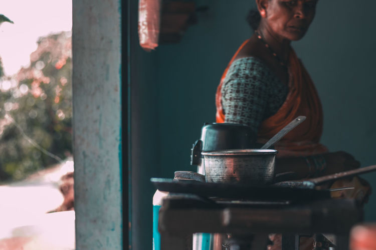 Woman Looking At Kitchen Utensils